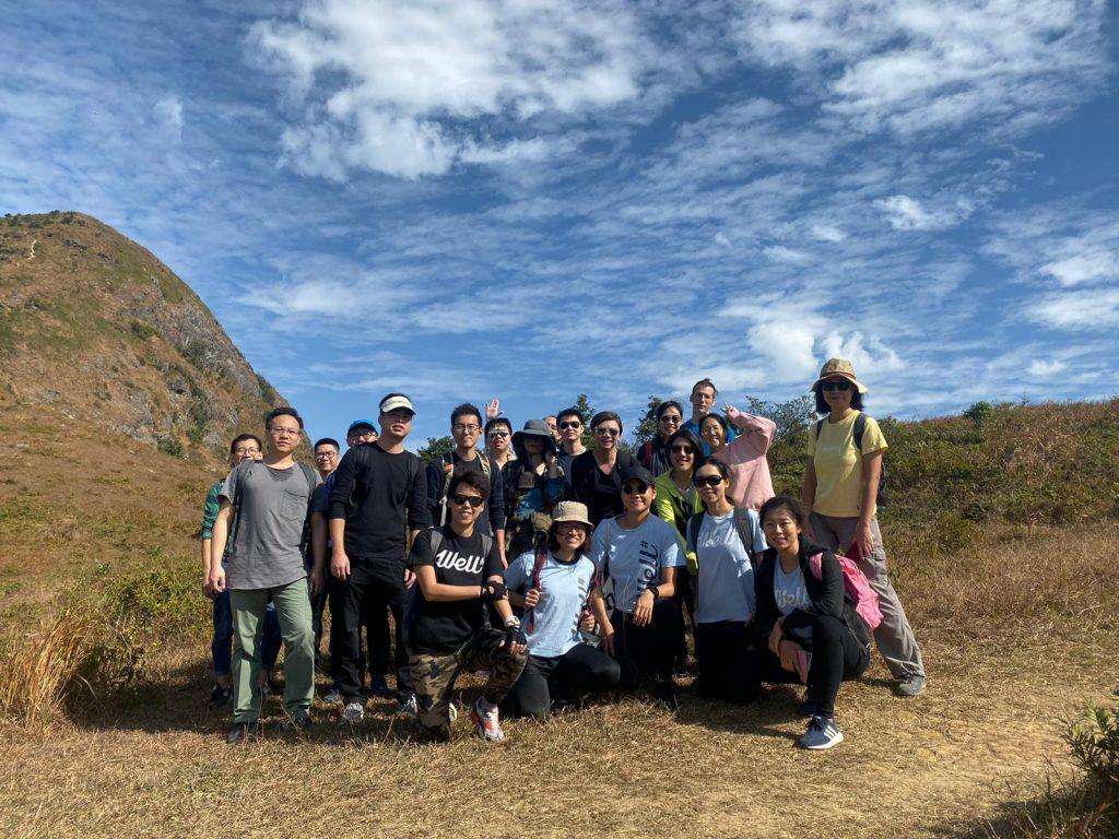 team hike up hill