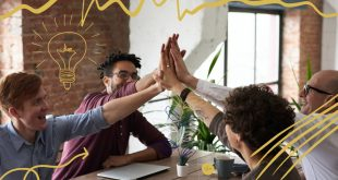 Happy Employees Giving Each other a High Five